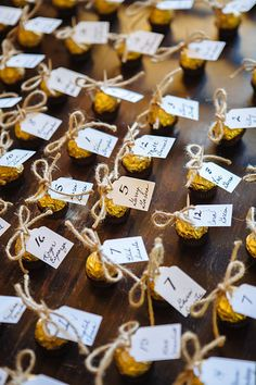 DIY wedding favors. Ferrero Rocher chocolates. Toothpick wraped with jute rope holding attendees name and table number.  Attendees are able to use toothpick to eat chocolate too!  Claremont, CA wedding.  Photo from Lauren & Greg collection by Tammy Horton Photography