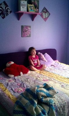 My girls share a queen bed, but they sleep on it from side to side instead of head to foot of the bed so they have more room. Problem: They don't make head boards that length. Solution: old twin box spring covered with old comforter! Then placed behind the bed. It's perfect!