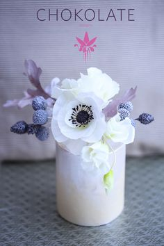 Wafer Paper Flowers: Winter bouquet composed of a white anemone,...