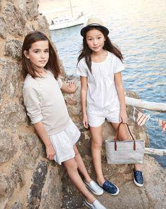 J.Crew girls floral cluster sweatshirt, metallic slip-on sneakers, pintuck top, eyelet pull-on short, and straw tote bag.