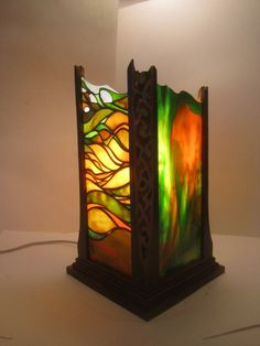 Unique stained glass and wood lantern.