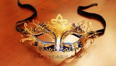 Just bought my mask for Halloween! The only black & gold version was sold out, so I totally have to pair this with a red dress now, but it's too pretty, I don't care!