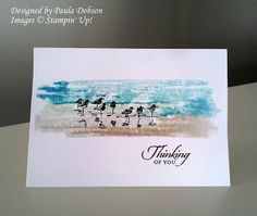 SU! Wetlands stamp set; spritz a clear block with water, run different blue and brown markers over the clear block and then spritz the block with a little water before stamping straight onto the Whisper White card base - Paula Dobson
