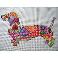 Cute as it comes this fabulous Patchwork Dog chart  Stitched size 7.1 inches x 4.2 on 14 count fabric. Contains only whole stitches and backstitch.  Full copyright is retained by the seller.