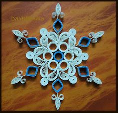 beautiful    B gave me a kit once and I don't know what happened to it.  I'd love to make her a snowflake like this!
