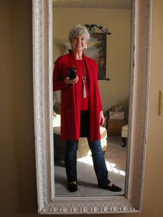 from Fifty, not Frumpy (nice blog) --- Love her edgier, shorter haircut, multi-season red sweater vest & long sleeve T to dress up or down, tassel necklace similar to one of mine (could NEVER manage with her miniscule purses however!)