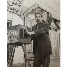 Kabul 1950s.  A box camera photograph of Abdul Samad  one of the earliest kamra-e-faoree photographers in Kabul. During the time of Zahir Shah (1933-1973) Abdul Samad travelled around the provinces taking identity photographs for the national identity card; he continued working as a photographer all of his life. He had his own photo shop in the Kote Sangi area of Kabul for over fifty years.  Afghanistan is one of the last places on earth where photographers used a simple type of instant…