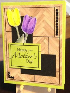 Mother's Day Card - Clearly Gina K. Stamps:  Inspiration Mosaic, Elegant Florals 2 - Inks:  Memento Tuxedo Black, Versafine Onyx Black - Faber-Castell Polychromos Pencils:  172, 174, 278, 109, 108, 106, 249,136, 137 - The Paper Studio Gemstones Black Round 4mm - Cardstock:  Gina K. Jelly Bean, Gina K. Artist's Choice, Stampin' Up Serene Scenery, The Paper Studio Heavy Weight Black - Inspiration:  http://melaniemuenchinger.blogspot.com/2015/11/video-faux-wood-grain-and-pieced-panels.html