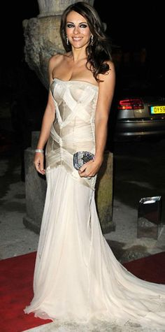 Look of the Day › November 4, 2010 WHAT SHE WORE Hurley attended the Elton John AIDS Foundation Winter Ball in a structured chiffon gown and crystal clutch.
