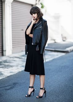 When in doubt, a moto jacket and midi dress is a fail-safe combination. A pair of ankle-strap heels doesn't hurt, either.