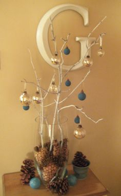 make a mini Christmas tree in a vase? Get creative with pine cones, bulbs, fake snow, etc.!
