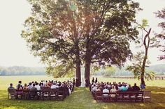 i love the two side by side trees as the background for this wedding...So pretty & meaningful.