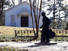 n this Dec. 10, 2009 photograph, a statue of a 13-year-old Elvis Presley stands before the church he attended as a child in Tupelo, Miss. Presley's youth is alive and celebrated by virtue of the museum documenting his early years and the maintenance of his birthplace and home. CREDIT: Getty Images