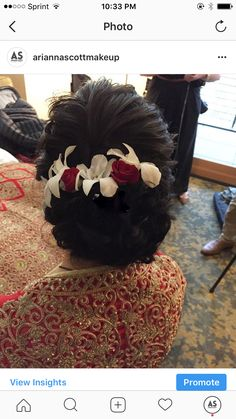 Orchids and roses added to textured updo Indian bridal bun