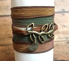 These beautiful silk wrap bracelet is made with the best quality hand dyed silk ribbon.   Measures approx 42 Inches long, wrap around the wrist several times and then tie or tuck the ends.  Add a stunning and feminine touch to any outfit. Sure to accent any wrist with stunning style and a gre...