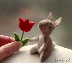 Hey, I found this really awesome Etsy listing at https://www.etsy.com/listing/182533334/brown-felt-bunny-with-felt-tulip