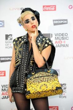 5d3afcb2efa3 Lady Gaga Leather Tote - Lady Gaga carried a bold leopard print tote with  black leather trim to the MTV Video Music Aid Japan event.