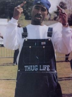 rap style thug fuck you black nigga Tupac thug life tupac shakur Gangsta rapper oldschool thuglife Tupac Amaru Shakur gangsta rap Black Style shakur leyenda Aleta real gangsta Tupac Wallpaper, Rap Wallpaper, Iphone Wallpaper, Arte Do Hip Hop, Hip Hop Art, Mode Hip Hop, 90s Hip Hop, Hip Hop Fashion, 90s Fashion