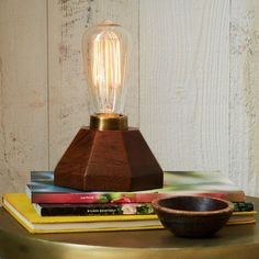 Featuring a bare bulb set atop an antiqued brass and faceted mango wood base, the Faceted Wood Bulb Lamp is perfect for the minimalist mid-century decorator.