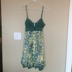 Flirty green summer dress Flirty green summer dress with corset like top and layered skirt with ruffle. Very flattering! The back right strap needs repair and is currently held with a safety pin, which I wore like that a couple times and someone less lazy or more talented could easy repair. Bought in expensive boutique in Boulder Colorado. Boutique  Dresses