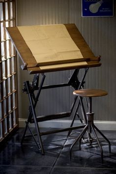 I sooooo want this drafting table and stool.