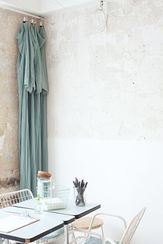 blue curtain and table with chairs / sfgirlbybay