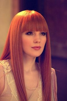 Love bangs, orange hair and brown eyes! And her lips are perfect!
