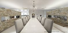 Modern but classic long dining table with large chairs and chandelier by: Decoussemaecker Interieurs