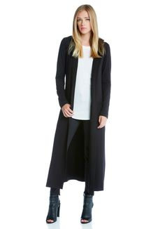 A long layer from Fifteen Twenty in toss-over-everything black jersey knit. A hood and pockets add to the cozy feel of this open front duster. High slits at each side make for easy layering and movement.