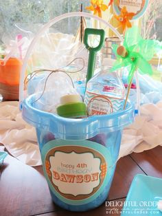 This gave me a cute idea - instead of 'gift bags' at the hotel for out of town guests, use a little beach pail! How cute! Splish Splash Birthday Party Ideas