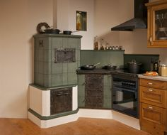 Kachelofen masonry heater Wood cookstove and oven faced in tile. Skandi Kitchen, Old Kitchen, Kitchen Decor, Old Stove, Stove Oven, Wood Panneling, Fireplace Heater, Wood Oven, Build Your House