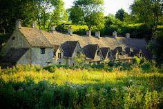 Arlington Row - 17th century workers cottages @ Bourton-on-the-Water, Gloucestershire, Cotswolds, England. Photo by by Cristina Cabel.