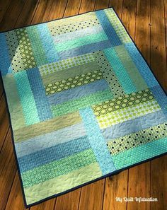 "Take a break from long and detailed quilt projects and spend an afternoon on a quick and easy fat quarter quilt with this Afternoon Tango Baby Quilt Tutorial. Made using budget-friendly fat quarters, this tutorial for <a href=""http://www.favequilts.com/Quilts-For-Baby/13-Free-Baby-Quilt-Patterns"" target=""_blank"" title=""40+ Free Baby Quilt Patterns"">how to make a baby quilt</a> uses simple strip piecing and lets you play around with the layout until yo..."
