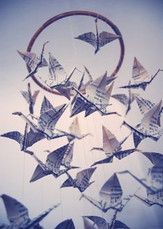 origami crane mobile from old book pages- 2 1/2 carts of weeded books could make a lot of cranes!