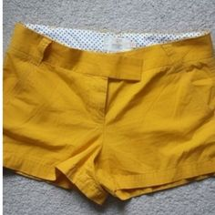 J. Crew Chino Shorts Mustard colored chino shorts worn a handful of times. Zipper, button and clasp closure. J. Crew Shorts
