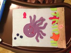 Octopus quiet book page with removable star fish.