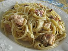 Salmon Spaghetti Carbonara is a wonderful and easy main dish recipe to make with leftover cooked salmon, Parmesan cheese, eggs, and heavy cream.