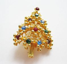 Check out this item in my Etsy shop https://www.etsy.com/listing/206764488/eisenberg-christmas-tree-brooch-gold