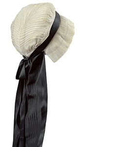 """Identified as """"18th century French cap with mourning crape"""" on a blog page about French Revolutionary-period mourning customs. http://www.blastmilk.com/personal-rambling/18th_century_mourning/  However, no source or provenance is noted. The black looks like ordinary silk ribbon, definitely not true mourning crape with its dull, diagonally crinkled appearance. Mourning crape was manufactured in the 19th c., but I'm not sure about the 18th. Does anyone have sources?"""