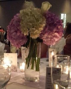 40 hydrangeas on white 40 in lavender 100 white roses 100 fresh water purple roses. The flowers were gorgeous.