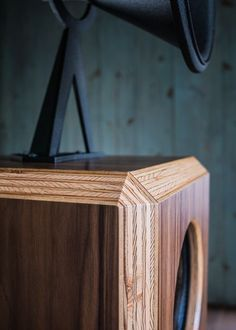 The OMA Mini is a unique two way horn based speaker with the performance of speakers much larger. The OMA Mini enclosure is a 14 cube, and the speaker stands 57