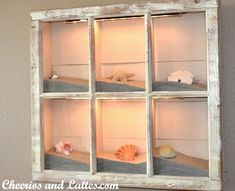 Beach Shadow Box (Source Unknown) old window frame + sand + shells and other accents + lights You can find lots of window frames at Habitat for Humanity for really cheap. Seashell Crafts, Beach Crafts, Seashell Projects, Sand Crafts, Crafts With Seashells, Diy Crafts, Seashell Ornaments, Frame Crafts, Snowman Ornaments