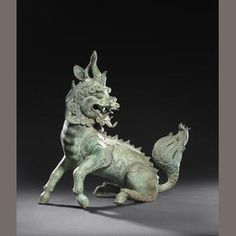 A large bronze late Ming/early Qing Chinese incense burner and cover in the form of a mythical qilin. (Bonhams)