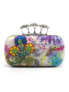 A Clutch Created By Hand Dyeing Silk In Unique Techniques To Reveal One Of A Kind Abstract Design. Adorned With Hand Embroidery Deatiling, This Clutch Is A Perfect Accompaniment For Indian And Western Outfits. Can Be Handheld Or Hung With The Detachable Sling Chain. #floral #clutch #bags