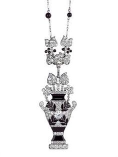 An exquisite Art Deco onyx and diamond pendant necklace by Cartier.