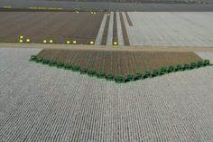 A 'V' formation of John Deere cotton pickers... I count 23... impressive.