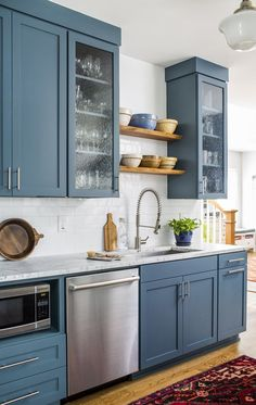 Farmhouse Style Country/Cottage Kitchen Design - I like the blue cabinets against the white! #affiliate #kitchendesign #farmhousekitchen #farmhousestyle #farmhouse