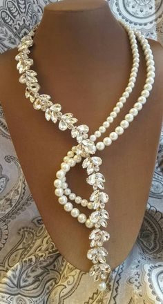 Check out this item in my Etsy shop https://www.etsy.com/ca/listing/488212468/pearl-and-crystal-rhinestone-necklace-y