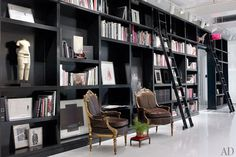 """Accessed via a wide hallway - one side of which is lined with floor to ceiling shelves displaying hundreds of books as well as an enviable array of art is his """"Sanctum"""""""