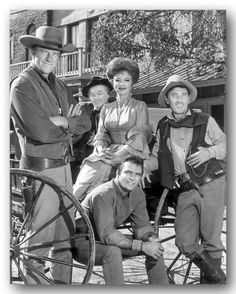 "The 'GUNSMOKE' gang. James Arness, Burt Reynolds, , Amanda Blake, Ken Curtis and Milburn Stone.  The television version ran for 20 seasons [1955 to 1975] - the longest-running prime time, live-action drama with 635 episodes. A columnist wrote ""Gunsmoke was the dramatization of the American epic legend of the west. Our own Iliad and Odyssey, created from standard elements of the dime novel and the pulp western as romanticized by Buntline, Harte, and Twain. It was ever the stuff of legend."""